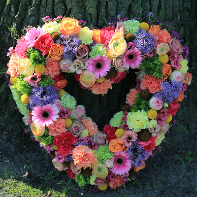 Wreath and heart Shaped Flowers delivery across Qatar